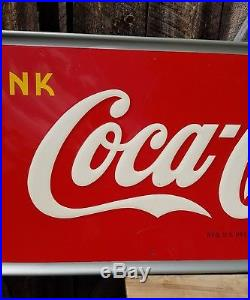 1948 Coca Cola Horizontal Sign with Bottle. 54inx18in. Embossed. Painted metal