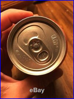 Factory sealed empty coca cola can